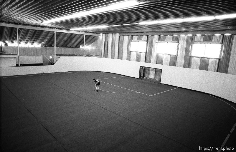 Lone goalie at an indoor soccer tournament.