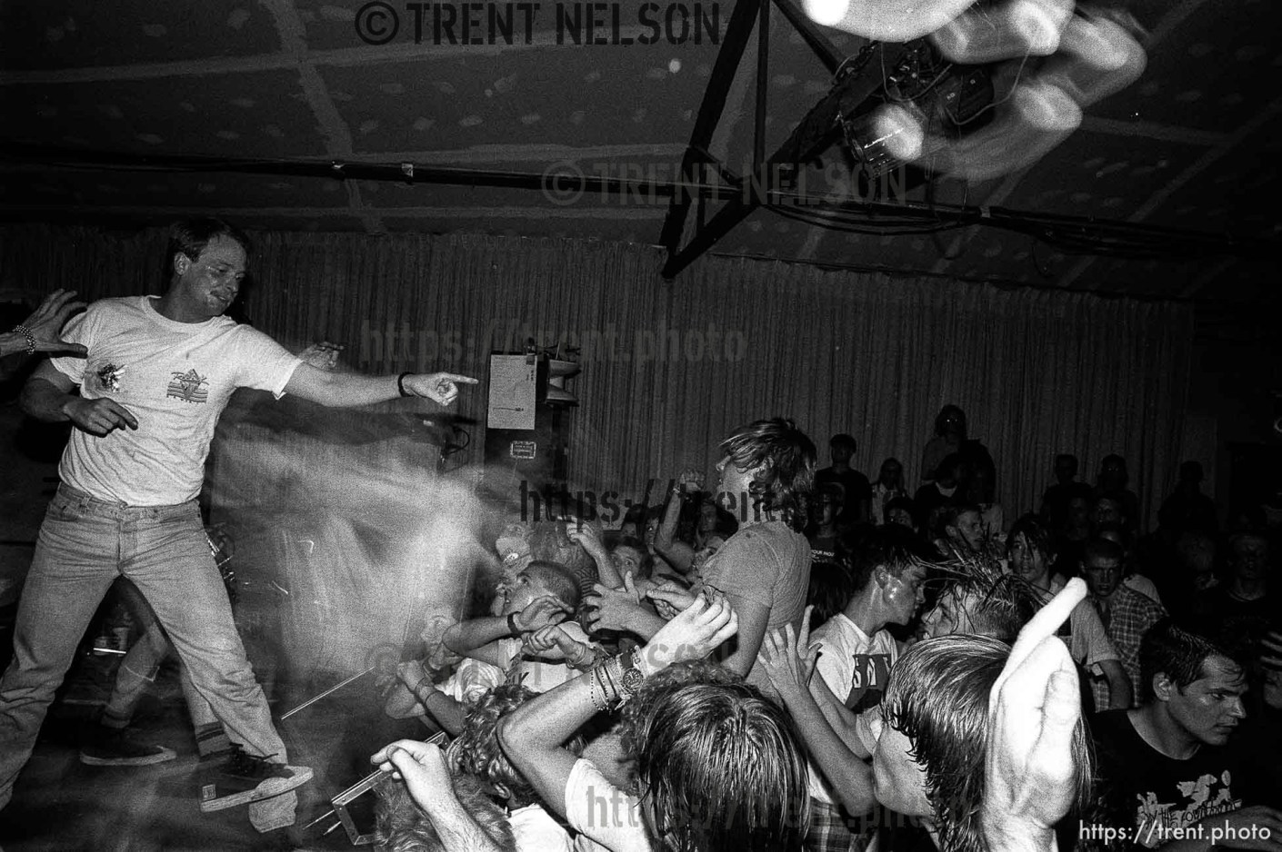 Security fighting with stage-diver and crowd at the SNFU concert at the Speedway Cafe.