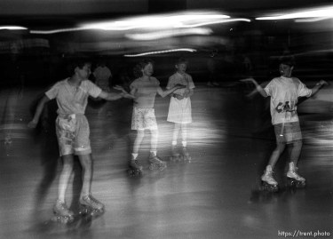 """Skate like an Egyptian."" Kids roller-skating at Classic Skating Rink."
