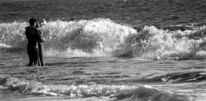 Couple embracing in waves.