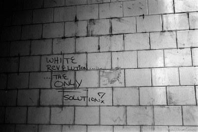 White revelution (sic) graffiti.