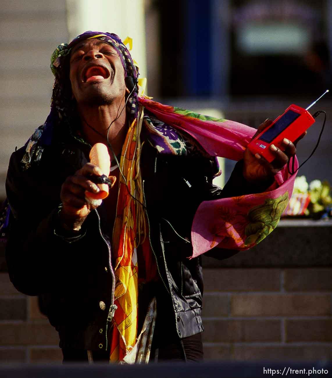 Guy singing into a dildo, november 1988.