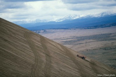 Dune buggies going up Sand Mountain.