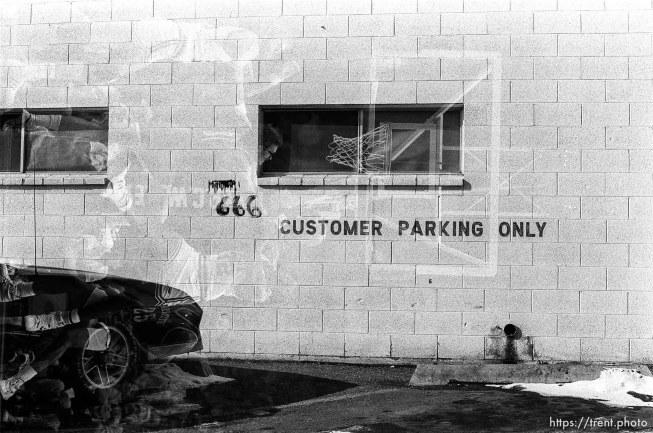 """Manowar"" stencil and ""666"" graffitied on Genealogy Center."