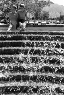 Jensens playing in fountain.