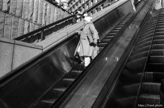 Woman on escalator on Market Street.