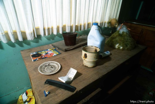 Strange table setting in abandoned house.