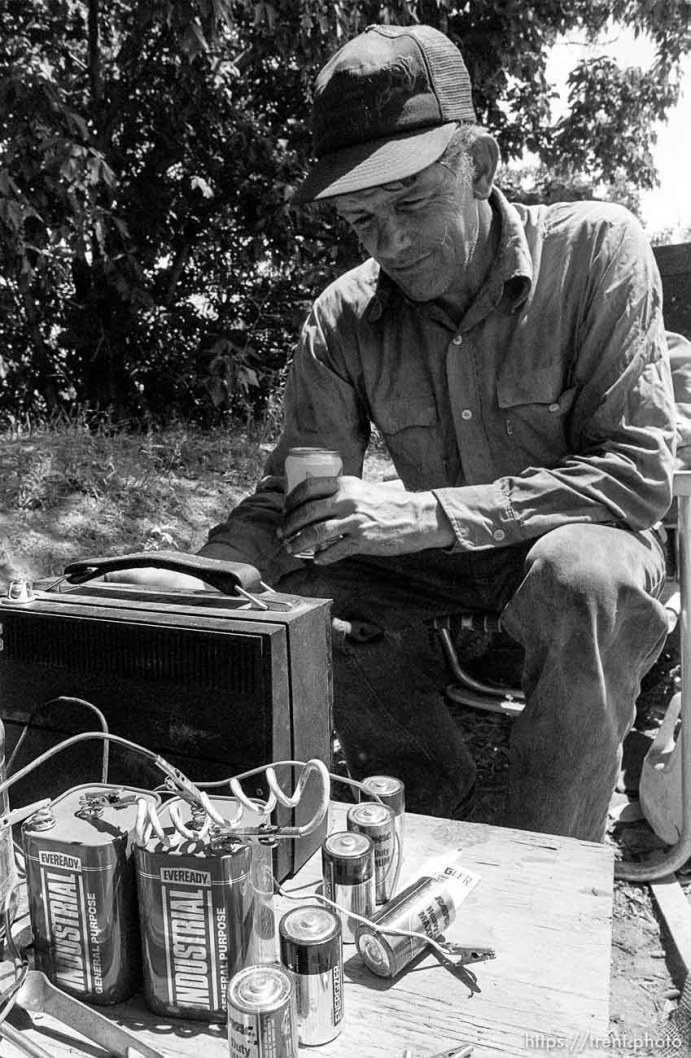 Casey works on a battery-powered radio.