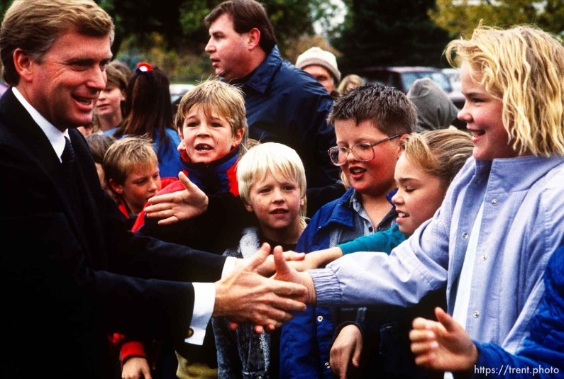 Dan Quayle shakes hands with elementary school children, 1990. p
