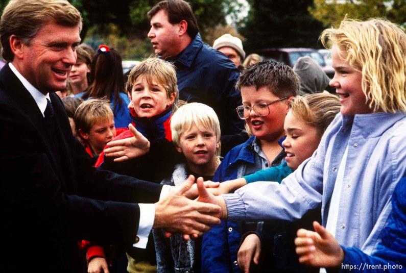 Dan Quayle shakes hands with elementary school children, 1990. p