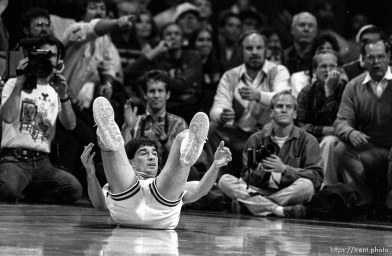 John Stockton laying on his back at Jazz vs. Detroit Pistons. In background (directly behind) Ravell Call and at right Bryan Anderton.