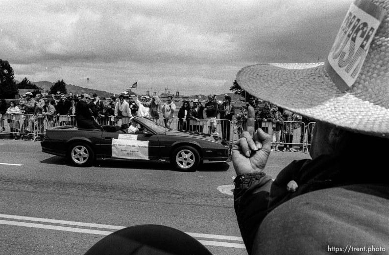 Man flips off officials at Gulf War celebration parade.