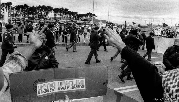 People flipping off veterans at Gulf War celebration parade.