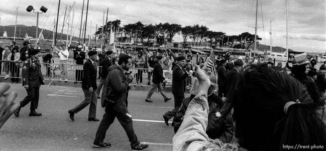 Protester flips off veterans at Gulf War celebration parade.