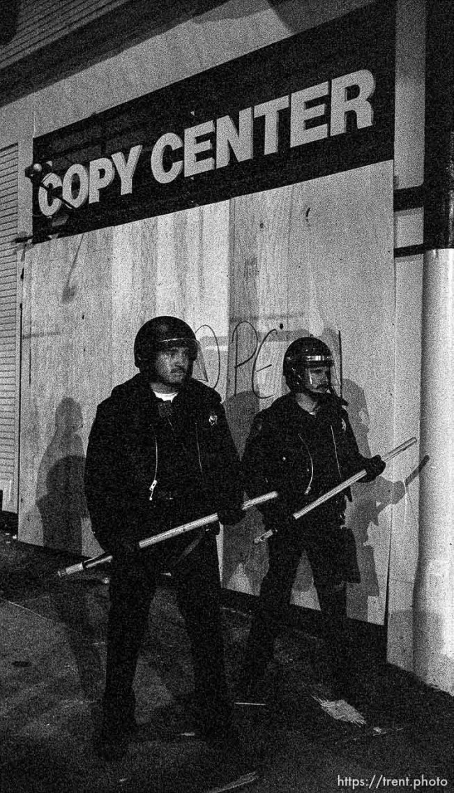 """Look-a-like cops under """"copy center"""" sign."""