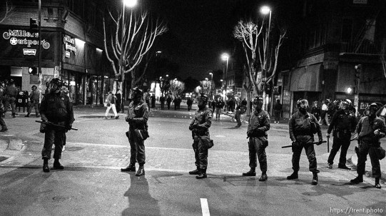 Riot police line up on Telegraph Avenue