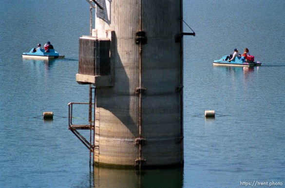 People on paddle-boats at the Lafayette Reservoir