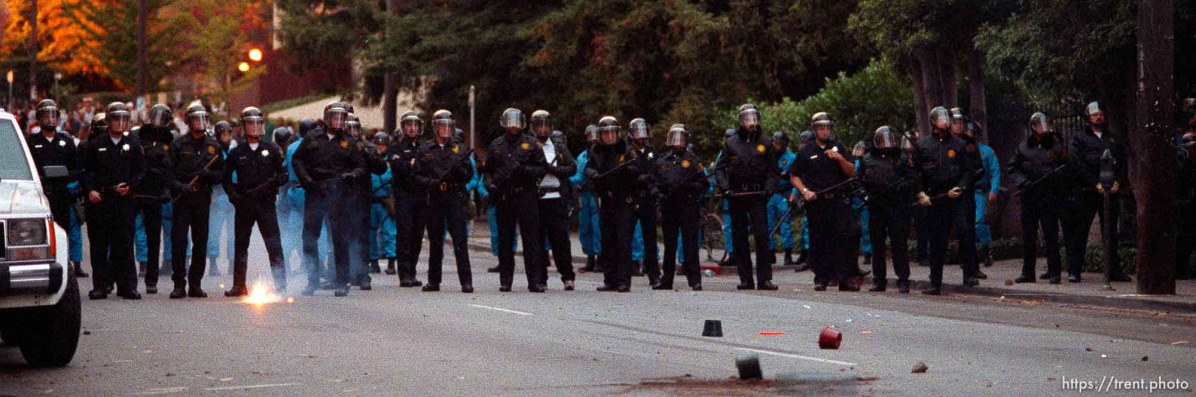 Police line is pelted with rocks during riots and protests.