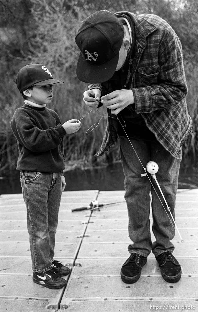 Big brother untangles little brother's fishing line at the Lafayette Reservoir