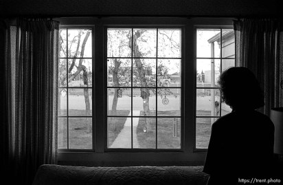 Phyllis Nelson looking out the front window of the Robinson home.