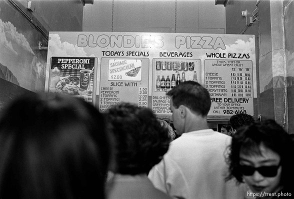 Blondie's pizza sign and customers