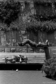 Anthony Quayle laying on rail above homeless man, who is also sleeping