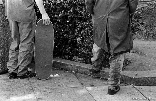 Anthony Quayle with homeless man (their feet)