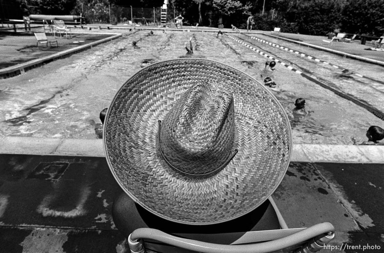 Lifeguard in straw hat at the Las Trampas Pool.
