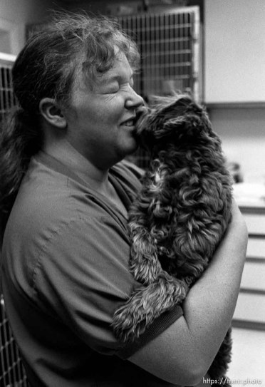 Nurse kissing dog at the Lafayette Animal Hospital