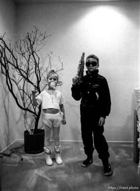 kids dressed up for Halloween. Treasure troll and the Terminator