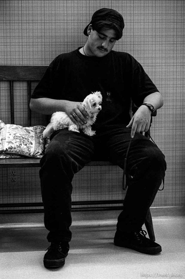 Guy in black with little, white dog at Lafayette Animal Hospital