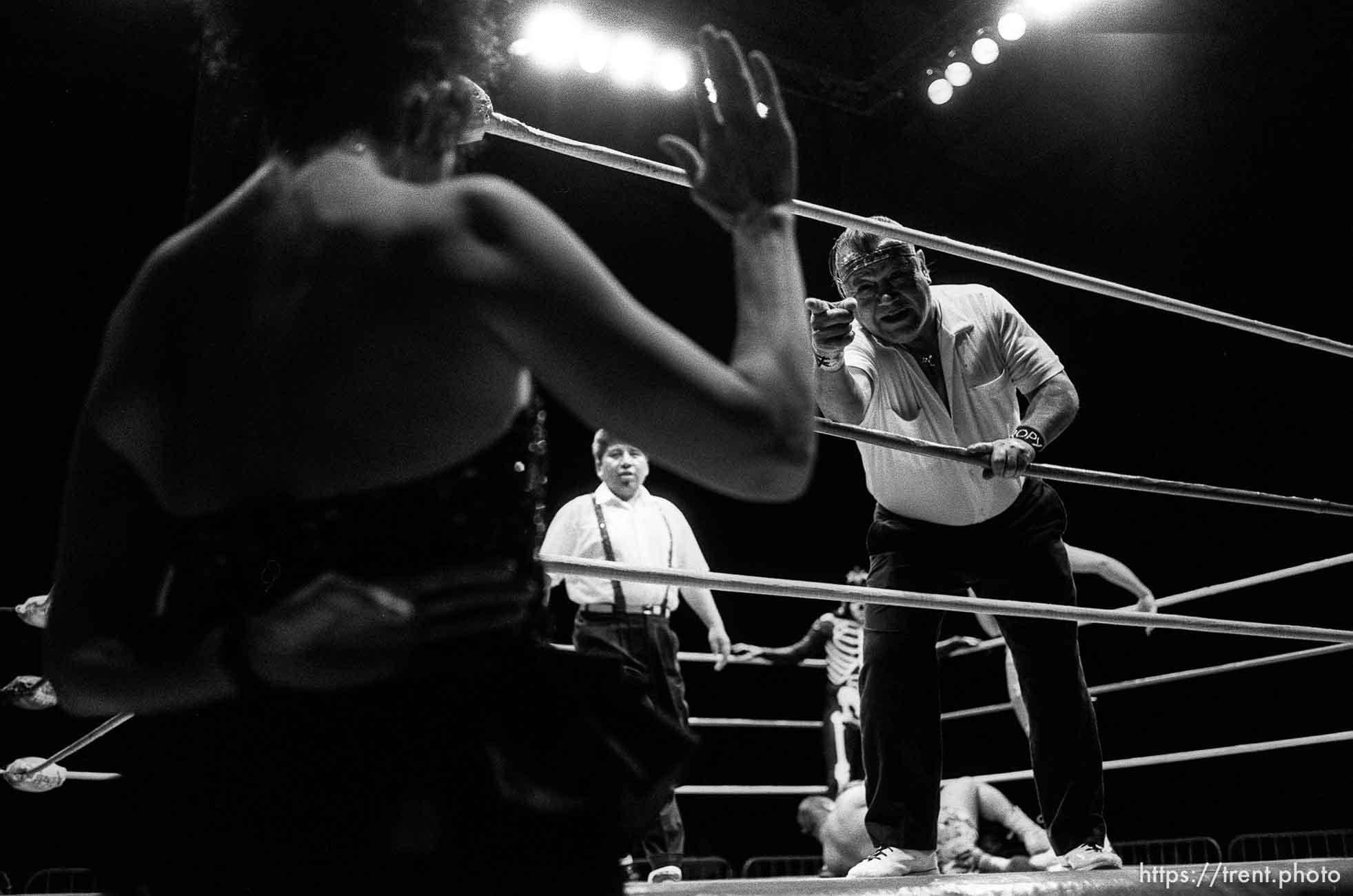 Wrestling action at Luche Libre pro-wrestling. Ref and Sensational Sherrie