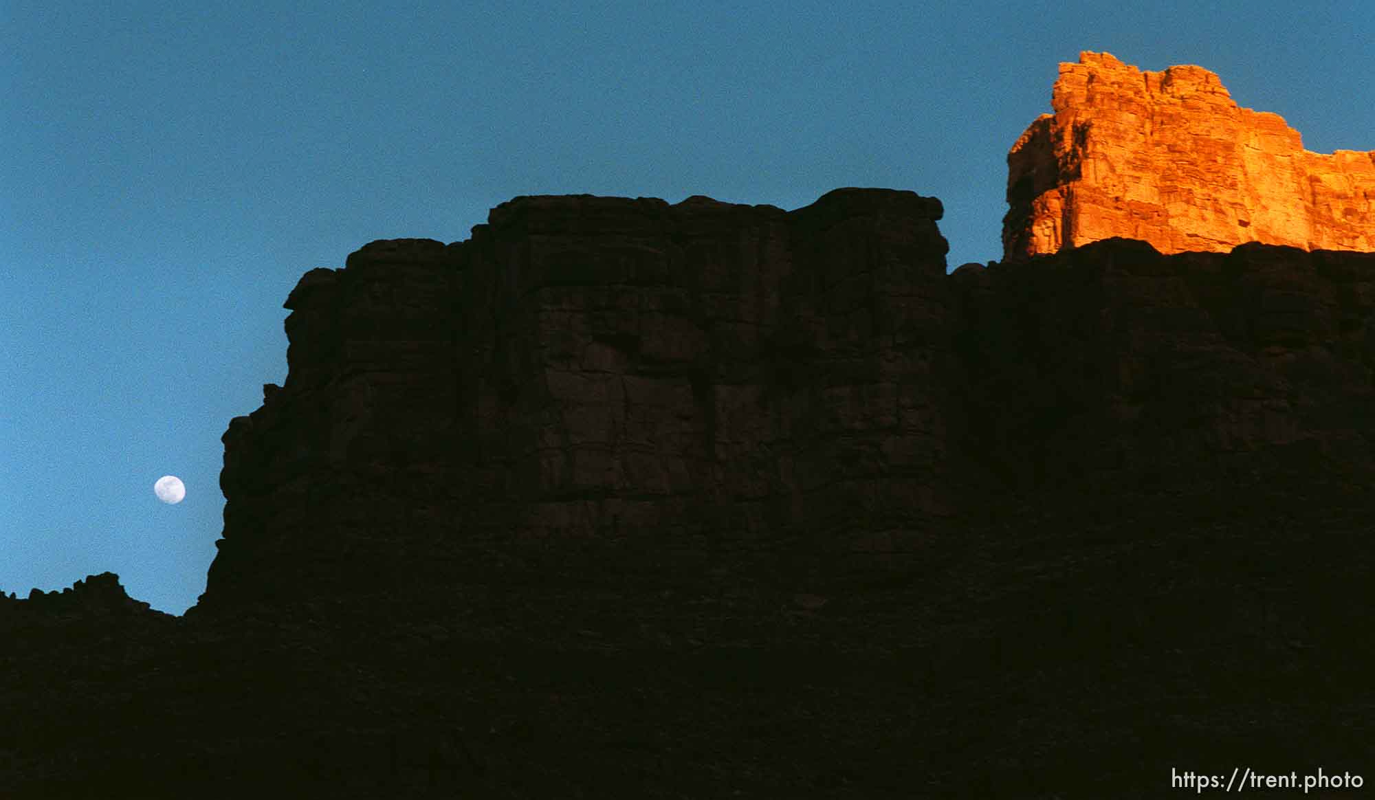 Full moon and canyon walls at sunset. Grand Canyon flood trip.