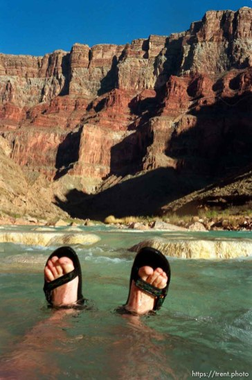 Trent feet in the Little Colorado's blue water. Grand Canyon flood trip.