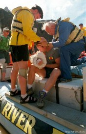 John and Dick give Steve an LDS priesthood blessing after he hyper-extended his elbow in Crystal Rapid. Grand Canyon flood trip.