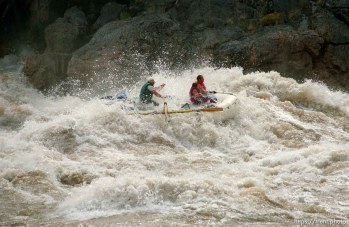Inflatable raft in Crystal Rapid. Grand Canyon flood trip.