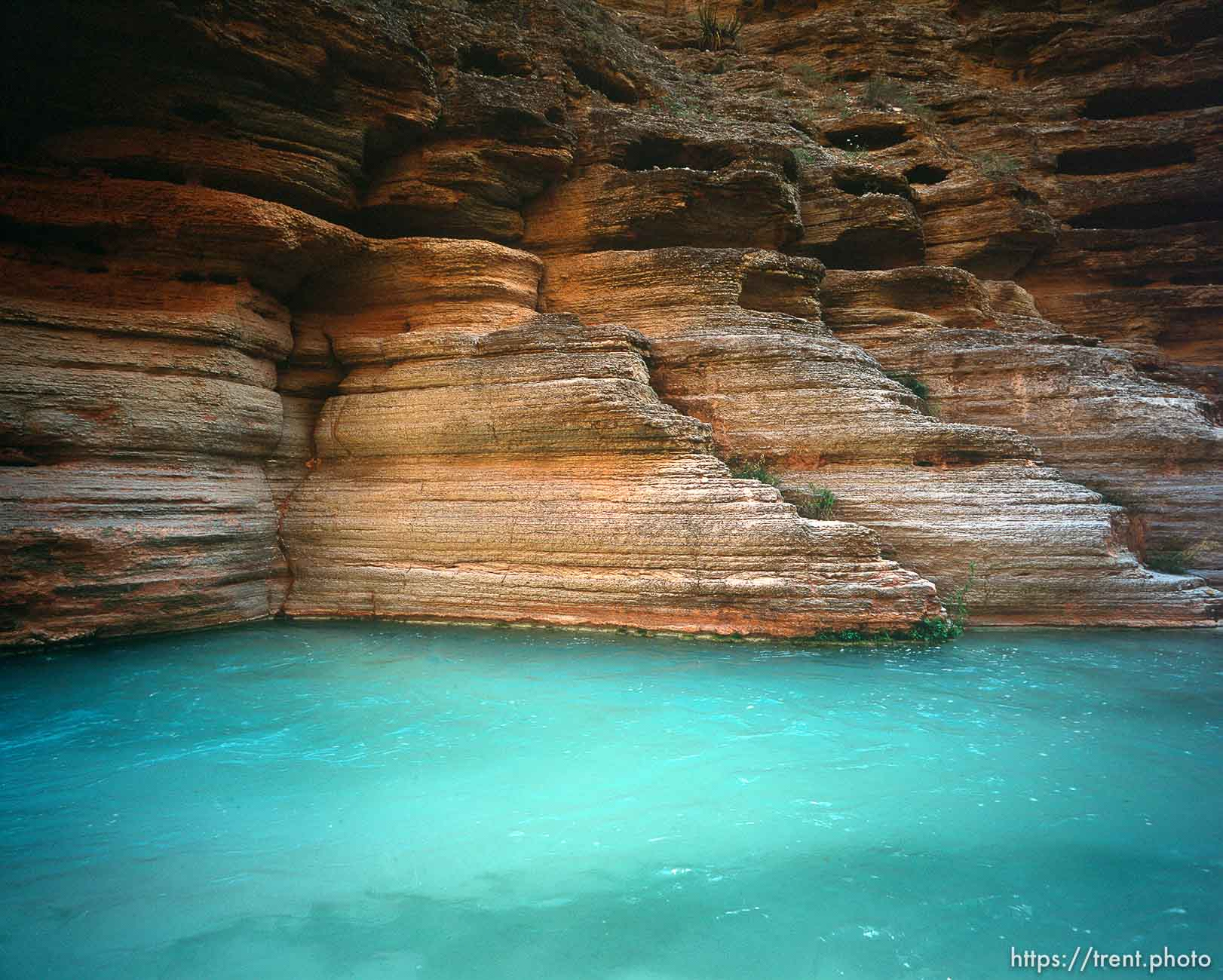 Blue water and rocks in Havisu Canyon. Grand Canyon flood trip.