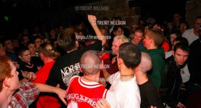 Straightedge kids beat on a longhaired Godflesh fan as he is thrown out of the club. Security figured it would be easier to remove one guy, rather than several violent kids.