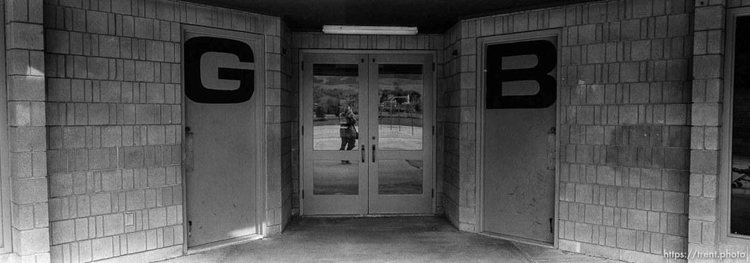 reflected in window with girls and boys bathroom dooors at Walt Disney Elementary School.