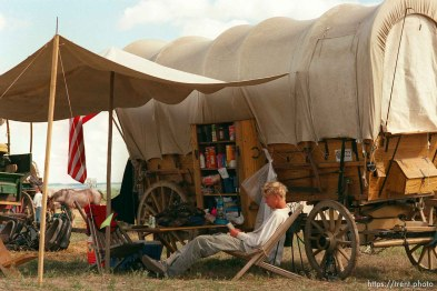 Brenton Whitaker reading in camp on the Mormon Trail Wagon Train.
