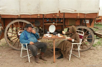 Charles and Mary Quillin, New Sharon, LA eating in camp on the Mormon Trail Wagon Train.