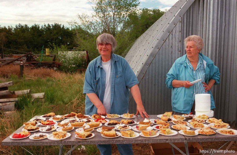 Donna Nelson and Lena Middleton selling pie for a dollar in camp on the Mormon Trail Wagon Train. The money was a fundraiser for Lena's daughter Susan Siffring, who has lukemia and just underwent a bone marrow transplant.