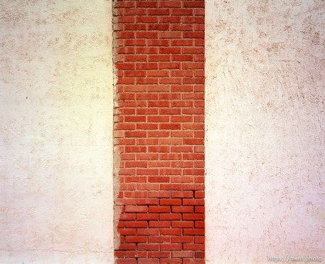 White wall with brick stripe.