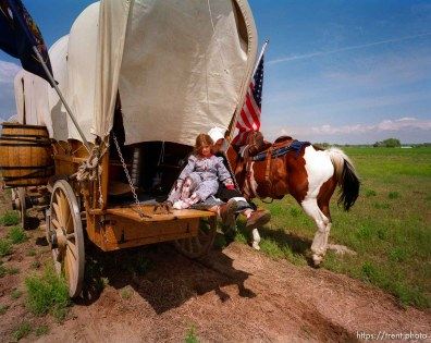 The Whitaker wagon (little girl is Aleah, other person is her mother, Mrs. Whitaker) along the Mormon Trail.