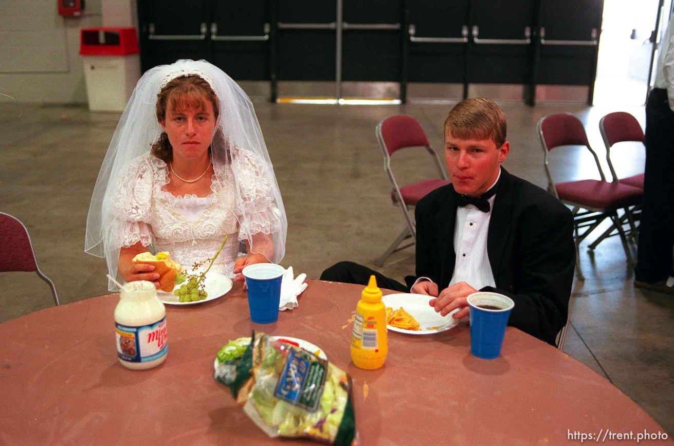 Crystal Dillon and Trevor Schmidt eat lunch. They were at the Salt Palace Convention Center preparing their float for the Days of '47 Parade. They play a bride and groom on the Moses Lake LDS Stake (Moses Lake, Washington).