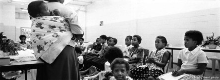Children in primary during an LDS church service. Zekey Tshetu (15 mos) is on his mother, Thirsly's back.
