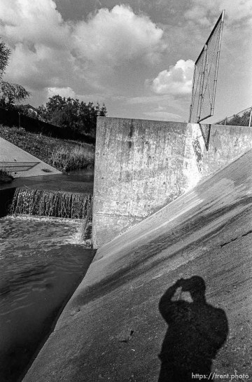 Trent shadow and concrete waterway in the creek.