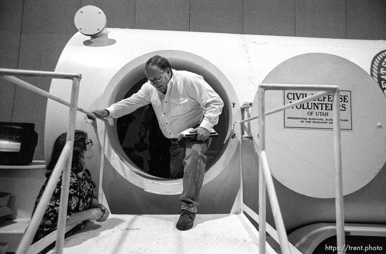 Man climbs out of bomb shelter at the Emergency Preparedness Expo at the Salt Palace Convention Center.