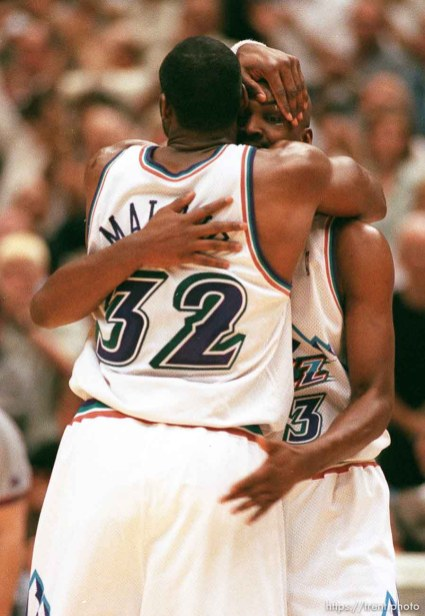 Utah's Karl Malone and Bryon Russell embrace near the end of Utah Jazz vs. Houston Rockets, game 5 of the 1st round, NBA Playoffs. Jazz won.