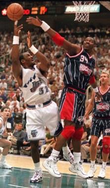 Utah's Karl Malone is blocked by Houston's Hakeem Olajuwon at Utah Jazz vs. Houston Rockets, game 5 of the 1st round, NBA Playoffs. Jazz won.